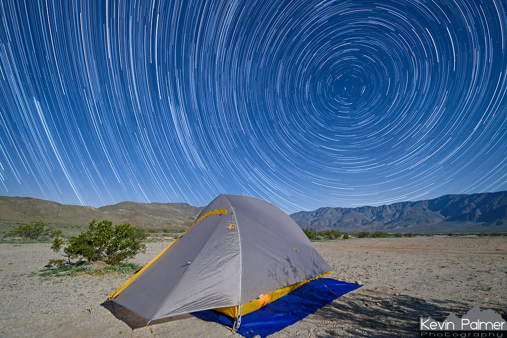 This image shows the stars apparent motion caused by the rotation of the earth. I setup my camera point at my tent while I camped in Anza Borrego.