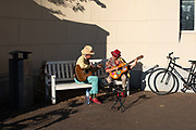 A couple plays gitar on Sunday afternoon in times of corona crisis. The Hague, Netherlands