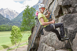 Rock climbers scaling a rock face at Oberried climbing garden, Otztal, Tyrol, Austria