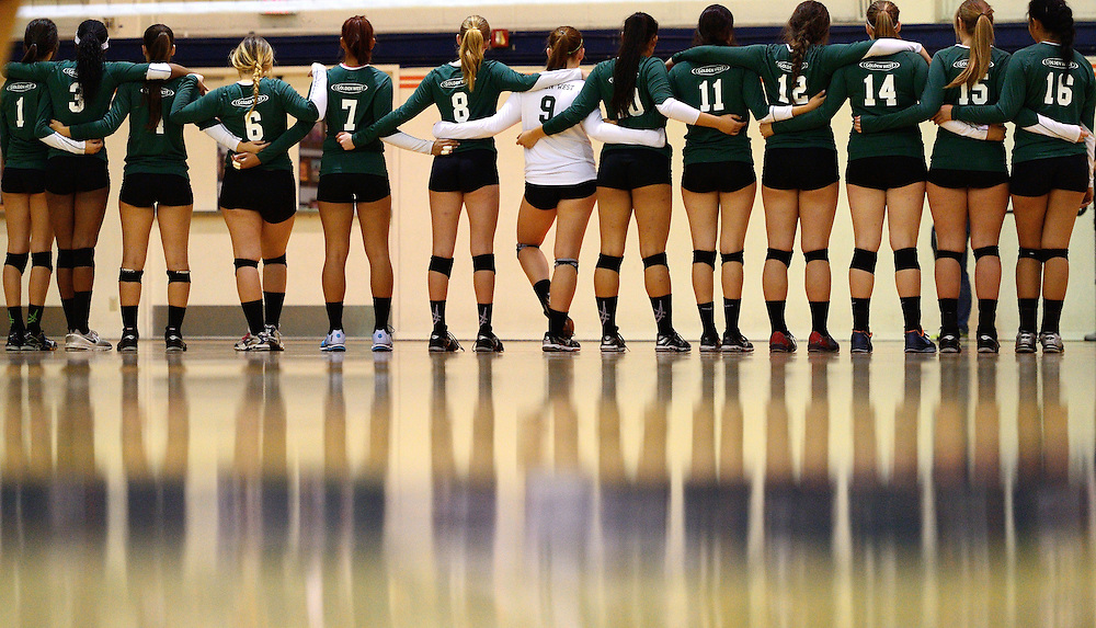 November 07, 2014:  The Golden West College Womens Volleyball team lines up before the start of the match Friday night on the Orange Coast College campus