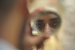 June 16, 2017 - Kathmandu, NP, Nepal - Nepaleses muslim checks 'surma' a herbal eye-liner after applied on his eyes before offering ritual prayer of Ramadan at Kashmiri Takiya Jame mosque at Kathmandu, Nepal on Friday, June 16, 2017. Ramadan (also known as Ramadhan or Ramzan) is the ninth month in the Islamic calendar. During the month of Ramadan, Muslims fast from dawn to dusk all over the world. While fasting from dawn until sunset, Muslims avoid from consuming food, drinking liquids, smoking, and engaging in sexual relations. (Credit Image: © Narayan Maharjan/NurPhoto via ZUMA Press)