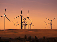 electric generating windmills in the Palouse region of eastern Washington, USA in evening light.