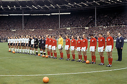 File photo dated 30-07-1966 of the two teams line up before the match: (left to right) West Germany's Horst-Dieter Hottges, Wolfgang Overath, Siggi Held, Helmut Haller, Wolfgang Weber, Lothar Emmerich, Willi Schulz, Franz Beckenbauer, Karl-Heinz Schnellinger, Hans Tilkowski and Uwe Seeler, linesman Tofik Bakhramov, referee Gottfried Dienst, linesman Karol Galba, England's Bobby Moore, George Cohen, Alan Ball, Gordon Banks, Roger Hunt, Ray Wilson, Nobby Stiles, Bobby Charlton, Geoff Hurst, Martin Peters, Jack Charlton.