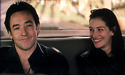 May 22, 2001; Hollywood, CA, USA; JULIA ROBERTS & JOHN CUSACK smiling together in the back of a car in 'America's Sweethearts'..  (Credit Image: ZUMA Press/ZUMAPRESS.com) (Credit Image: © ZUMA Press/Entertainment Pictures/ZUMAPRESS.com)