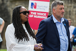 London, UK. 20th July, 2021. Labour MPs Dawn Butler and Ian Byrne show support to NHS workers from the grassroots NHSPay15 campaign meeting outside Parliament before marching to 10 Downing Street to deliver a petition signed by over 800,000 people calling for a 15% pay rise for NHS workers. At the time of presentation of the petition, the government was believed to be preparing to offer NHS workers a 3% pay rise in 'recognition of the unique impact of the pandemic on the NHS'.