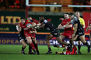 Scott Williams of Scarlets gets away from Semi Radradra Turagasoli Waqavatu of Toulon (c).EPCR European Champions cup match, Scarlets v RC Toulon at the Parc y Scarlets in Llanelli, West Wales on Saturday 20th January 2018. <br /> pic by  Andrew Orchard, Andrew Orchard sports photography.