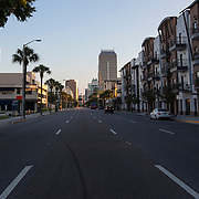 Orange Avenue is virtually empty at the end of business day due to a stay at home order that was issued by Orange County government on Friday, March 27, 2020 in Orlando, Florida.  (Alex Menendez via AP)