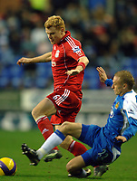 Photo: Paul Greenwood.<br />Wigan Athletic v Liverpool. The Barclays Premiership. 02/12/2006. Liverpools John Arne Riise, left, gets the better of Wigan's David Cotterill