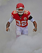 Strong safety Tyrann Mathieu #32 of the Kansas City Chiefs runs through a cloud of smoke, as he is introduced prior to the game against the Baltimore Ravens at Arrowhead Stadium in Kansas City, Missouri.