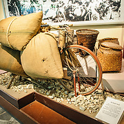 An exhibit with a bicycle for transporting sacks of rice and other supplies to the front lines during the Vietnamese wars of the 20th century. The museum was opened on July 17, 1956, two years after the victory over the French at Dien Bien Phu. It is also known as the Army Museum (the Vietnamese had little in the way of naval or air forces at the time) and is located in central Hanoi in the Ba Dinh District near the Lenin Monument in Lenin Park and not far from the Ho Chi Minh Mausoleum.