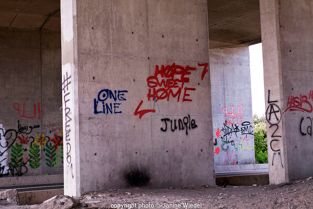 Graffiti by the Calais Jungle where more than 5,000 migrants and refugees are living in temporary shelters