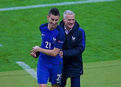 PARIS, FRANCE - Sunday, July 3, 2016: France's head coach Didier Deschamps jokes with Laurent Koscielny as he is substituted against Iceland during the UEFA Euro 2016 Championship Semi-Final match at the Stade de France. (Pic by Paul Greenwood/Propaganda)