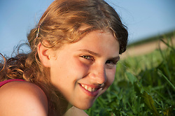 Portrait of a girl (12-13) in field, close-up
