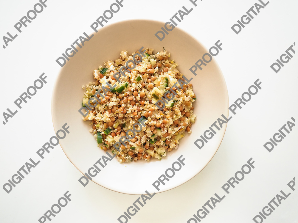 Quinoa and lentils salad in a plate viewed from above - flaylay concept