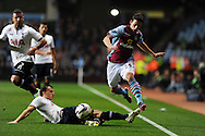 Aston Villa's Aleksandar Tonev skips the tackle by Tottenham's Vlad Chiriches. . Capital one cup 3rd round match, Aston Villa v Tottenham Hotspur at Villa Park in Birmingham on Tuesday 24th Sept 2013. pic by Andrew Orchard, Andrew Orchard sports photography.