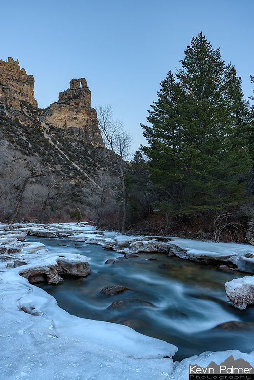 Most of the snow had melted in Tongue River Canyon, but some ice remained near the riverbanks. After the sun set, I setup my tripod on the edge of the ice to try a long exposure.