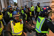 Riot police form a circular wall around two arrested protestors aiming to load them over to a police van after they clashed with protesters in central London on Wednesday, June 3, 2020. (Photo/ Vudi Xhymshiti)