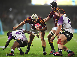 Cape Town-180416  University of Stellenbosch player Niel Oelofse  tackled by Tapuwa Mafura of UNW in a Varsity Cup final played at Dani Craven stadium in Sellenbosch .photographer:Phando Jikelo/African News Agency/ANA