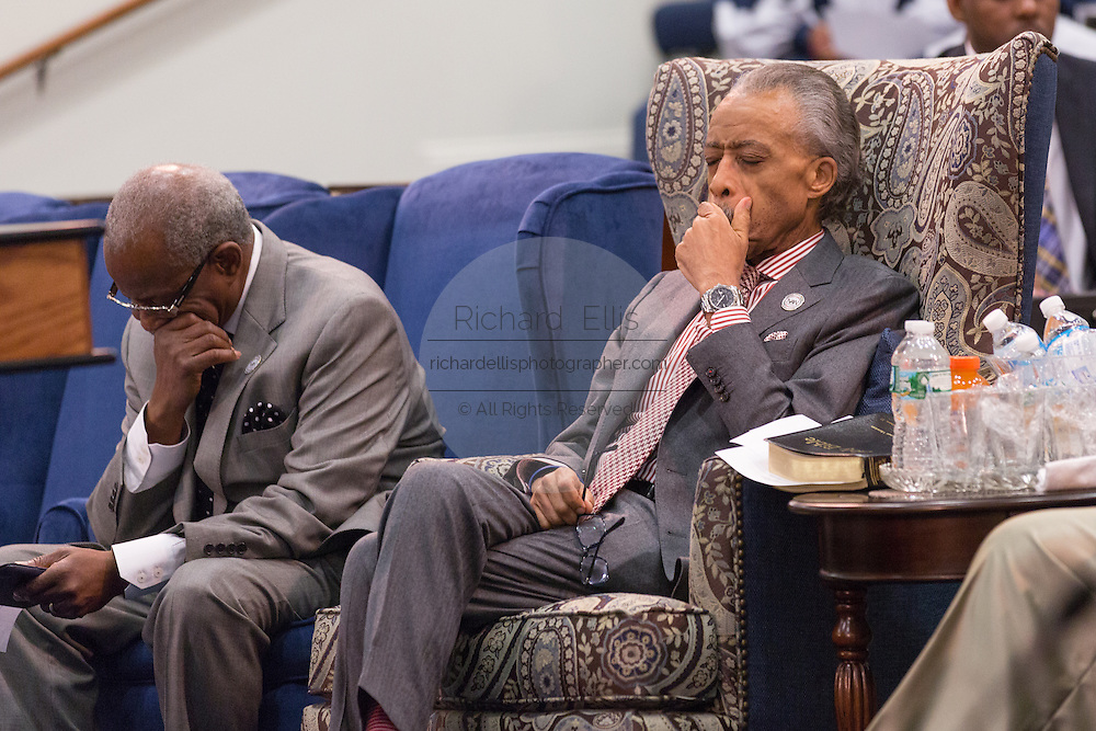 Rev. Al Sharpton prays during a healing service at Charity Missionary Baptist Church April 12, 2015 in North Charleston, South Carolina. Sharpton spoke following the recent fatal shooting of unarmed motorist Walter Scott police and thanked the Mayor and Police Chief for doing the right thing in charging the officer with murder.