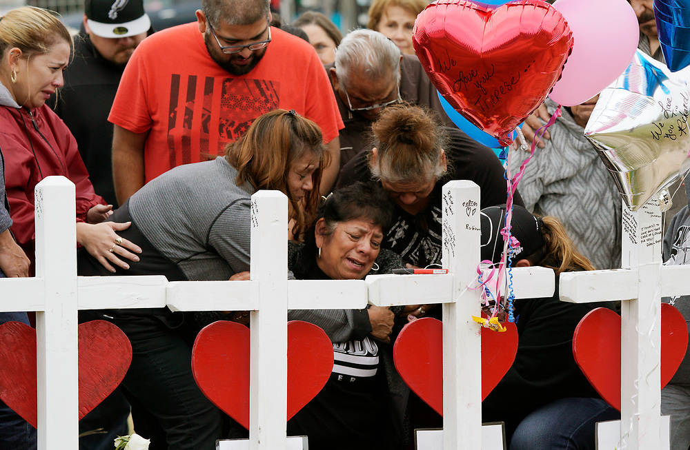 Lilly Navejas weeps at the crosses for her killed brother Richard Rodriguez and sister-in-law Theresa Rodriguez at crosses placed for those killed in the shooting at the First Baptist Church of Sutherland Springs, Texas, U.S.  November 10, 2017.  REUTERS/Rick Wilking