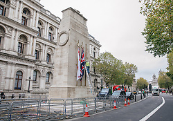 © Licensed to London News Pictures. 09/11/2017. London, UK. Workmen hang flags on the Cenotaph ahead of Armistice Day. Palace of Westminster clockmakers rang Big Ben at 9am and will work through the day adjusting the bells to ensure that they strike at exactly the right time for Armistice Day commemorations at the 11th hour of November 11, followed by Remembrance Sunday events the following day. Photo credit: Rob Pinney/LNP