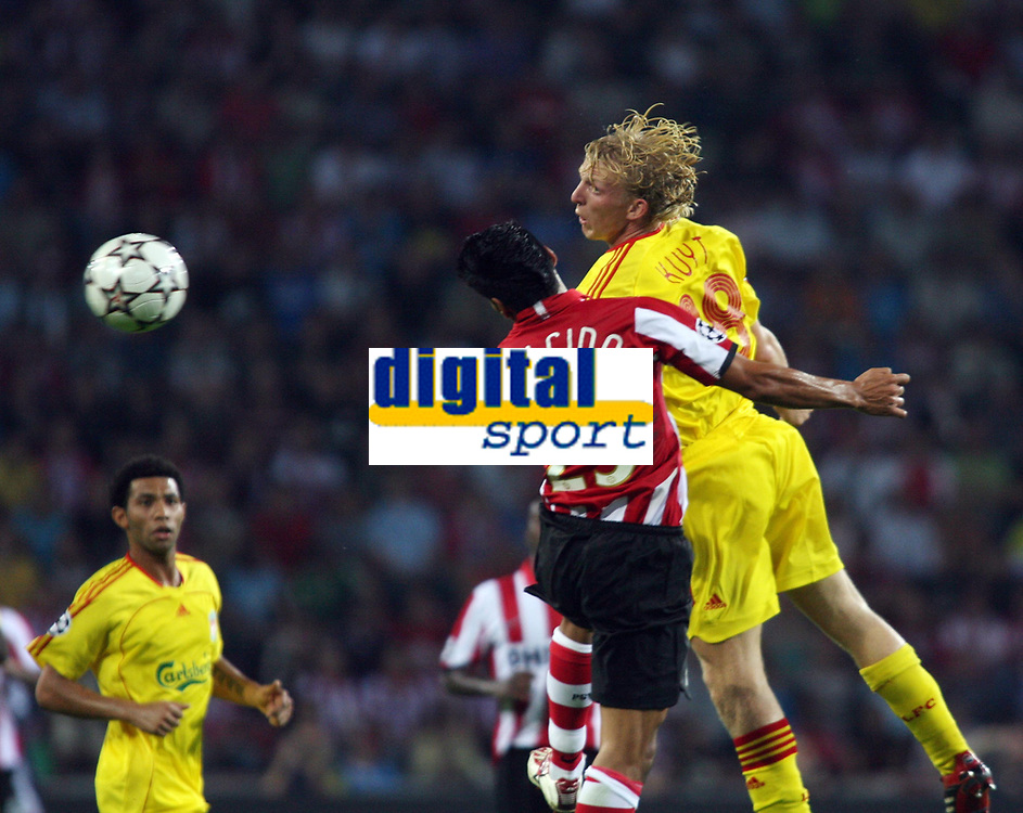 Photo: Chris Ratcliffe.<br /> PSV Eindhoven v Liverpool. UEFA Champions League, Group C. 12/09/2006.<br /> Dirk Kuijt of Liverpool clashes with Carlos Salcido of PSV Eindhoven.