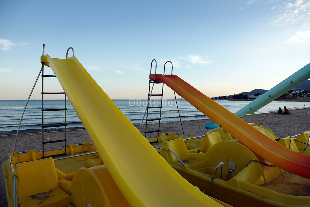 paddle boats with gliding ramp by the sea