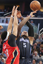 December 22, 2017 - Orlando, FL, USA - The New Orleans Pelicans' Anthony Davis (23) fouls the Orlando Magic's Marreese Speights (5) at the Amway Center in Orlando, Fla., on Friday, Dec. 22, 2017. (Credit Image: © Stephen M. Dowell/TNS via ZUMA Wire)