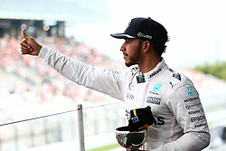 GP von Japan 2016 in Suzuka / 091016<br /> <br /> ***Formula One Grand Prix of Japan on October 9, 2016 in Suzuka.***<br /> <br /> GP von Japan 2016 in Suzuka / 091016<br /> <br /> ***Formula One Grand Prix of Japan on October 9, 2016 in Suzuka.***<br /> <br /> Lewis Hamilton (GBR) Mercedes AMG F1 celebrates his third position on the podium.<br /> 09.10.2016. Formula 1 World Championship, Rd 17, Japanese Grand Prix, Suzuka, Japan, Race Day.<br />  - www.xpbimages.com, EMail: requests@xpbimages.com - copy of publication required for printed pictures. Every used picture is fee-liable. © Copyright: Bearne / XPB Images