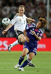09-07-2011 VOETBAL: FIFA WOMENS WORLDCUP 2011 GERMANY - JAPAN: WOLFSBURG<br /> Melanie Behringer (GER) gegen Mana Iwabuchi (JPN) <br /> ***NETHERLANDS ONLY***<br /> ©2011-FRH- NPH/Karina Hessland