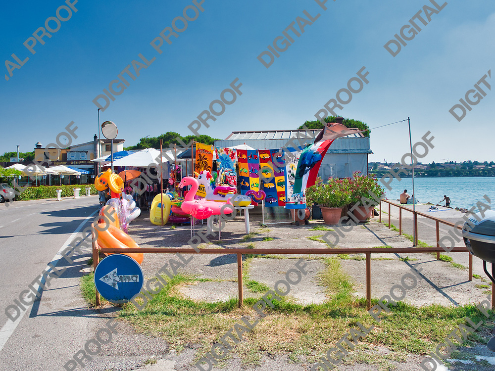 Inflatable beach tent on the shores of Lake Garda in Italy during a sunny summer afternoon