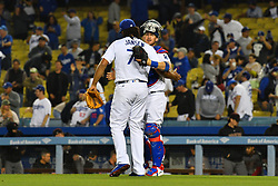 May 10, 2018 - Los Angeles, CA, U.S. - LOS ANGELES, CA - MAY 09: Los Angeles Dodgers Pitcher Kenley Jansen (74) hugs Los Angeles Dodgers Catcher Yasmani Grandal (9) after a MLB game between the Arizona Diamondbacks and the Los Angeles Dodgers on May 9, 2018 at Dodger Stadium in Los Angeles, CA. (Photo by Brian Rothmuller/Icon Sportswire) (Credit Image: © Brian Rothmuller/Icon SMI via ZUMA Press)