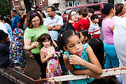 BETHLEHEM, PA – JUNE 11, 2011: Families wait in line on Saturday morning for the opening of the 15th annual Great South Side Sale in Bethlehem, where used items left by Lehigh University students are sold to the public. All proceeds from the sale benefit homework clubs at local elementary and middle schools.<br /> <br /> As the population of second and third generation Hispanics increases dramatically in the United States, a new boldness can be sensed among Latinos in America, stretching far beyond the southern border states. Demographers in Pennsylvania say the towns of Bethlehem, Allentown and Reading are set to become majority-minority cities, where Hispanics comprise a bigger portion of the population than whites. As this minority population increases dramatically in the region, Latinos are inching closer to their own realization of the American Dream, while gradually shifting the physical and cultural landscapes of their communities.
