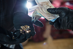 Burglars stealing jewelry and Euro banknotes
