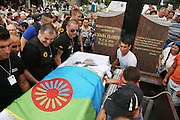 """Florin Cioba, the deceased King of the Roma Gypsies is placed in his grave at Sibiu cemetry. His coffin is covered with a Roma flag. The Cartwheel and earth and sky emblem. Arrival at the cemetery and Florin Cioaba is buried with a huge crowd accompanying him.<br /><br />Florin Ciaoba's funeral and the crowning of two kings. Daniel and Dorian were crowned, Danile with the bigger crown is King of Romanian Roma Gypies whilst his older Brother Dorian has the smaller crown and is King of Gypsies of the world and deals with foriegn affairs. His hearse (a lorry) packed with security guards is taken from The Cioaba family home to the cemetery<br /><br />Florin Tănase Cioabă (1954 – 18 August 2013) was a Romanian Romani Pentecostal minister and self-proclaimed """"King of Roma around the world"""". He died on 18 August 2013 of cardiac arrest at Akdeniz Üniversitesi in Antalya. He was 58 years old.<br /><br />In September 2003, Florin Cioaba sparked controversy when he married his 12 year-old daughter Ana-Maria to Mihai Bitrita, a Roma boy aged 15. However, following the wave of criticism, he promised to work to uproot the tradition of child marriages among the Roma. Florin Cioaba also encouraged Roma families to send their children to school during his attempt to fight poverty resulting from a lack of education.<br /><br />Cioaba was elected president of the International Romani Union in April this year"""