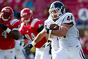 DALLAS, TX - NOVEMBER 16: Max DeLorenzo #44 of the Connecticut Huskies breaks free against the SMU Mustangs on November 16, 2013 at Gerald J. Ford Stadium in Dallas, Texas.  (Photo by Cooper Neill/Getty Images) *** Local Caption *** Max DeLorenzo