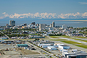 Anchorage the largest city in Alaska on the shores of Cook Inlet overlooking the Alaska and Chugach mountain ranges has a population of 550,000 people