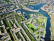 Nederland, Noord-Holland, Gemeente Amsterdam; 02-09-2020; Kattenburg, Dijksgracht en Oosterdok. Marineterrein (Marine Etablissement Amsterdam) en Scheepvaartmuseum. Rechts de ingang van IJtunnel, met  Nemo Science Museum <br /> Eastern Dock with new hotspot former Navy yard.<br /> <br /> luchtfoto (toeslag op standaard tarieven);<br /> aerial photo (additional fee required)<br /> copyright © 2020 foto/photo Siebe Swart