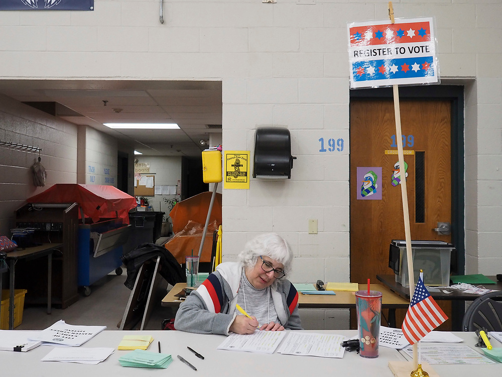 A New Hampshire voter registrar reviews new voter registrations. New voters can register on the day of the primary in New Hampshire.