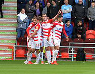 Doncaster players celebrate a goal during the EFL Sky Bet League 1 match between Doncaster Rovers and Coventry City at the Keepmoat Stadium, Doncaster, England on 4 May 2019.