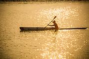 Man Paddling a Kayak in the Ocean at Sunset