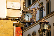 Clock and lantern, Piazza San Giovanni, Florence, Tuscany, Italy