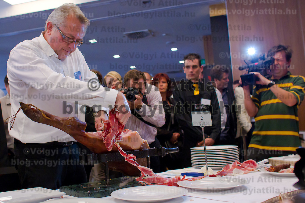 Laszlo Arpas winner of the competition works during the first ever ham slicing competition in Budapest, Hungary on May 9, 2012. ATTILA VOLGYI