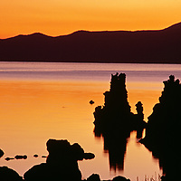 The sun rises over over tufa towers in Mono Lake, an ancient inland sea.