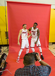 September 25, 2017 - Miami, Florida, U.S. - Miami Heat guard Goran Dragic (7) and Miami Heat forward Udonis Haslem (40) pose for Miami Herald photographer David Santiago during at Media Day at AmericanAirlines Arena in Miami, Florida on September 25, 2017. (Credit Image: © Allen Eyestone/The Palm Beach Post via ZUMA Wire)