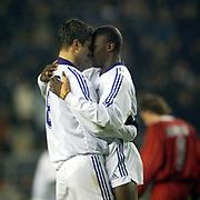 Anderlecht's goalscorer Aruna Dindane and team mate Michal Zewlakow (l) celebrate the opening goal against Bordeaux