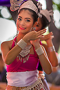 19 APRIl 2014 - BANGKOK, THAILAND: A girl performs Isaan music at the Rattanakosin Festival in Bangkok. Rattanakosin is the name of the man made island that is the heart of the old city. Bangkok was formally founded as the capital of Siam (now Thailand) on 21 April 1782 by King Rama I, founder of the Chakri Dynasty. Bhumibol Adulyadej, the current King of Thailand, is Rama IX, the ninth King of the Chakri Dynasty. The Thai Ministry of Culture organized the Rattanakosin Festival on Sanam Luang, the royal parade ground in the heart of the old part of Bangkok, to celebrate the city's 232nd anniversary.    PHOTO BY JACK KURTZ
