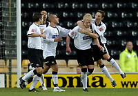 Photo: Glyn Thomas.<br />Derby County v Norwich City. Coca Cola Championship.<br />03/12/2005.<br />Derby's Andy Davies (second from R) is mobbed by teammates after giving his side a 1-0 lead.