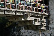 Details of the cantilevered timbers supporting the Nyamai Zam bridge over the Paro Chu river. Paro, Druk Yul, Bhutan. 12 November 2007.