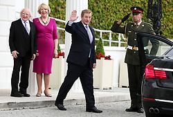 President Michael D Higgins and wife Sabina Coyne watch outgoing Taoiseach Enda Kenny (centre) leaving the Aras an Uachtarain in Dublin, on his last day as Taoiseach.